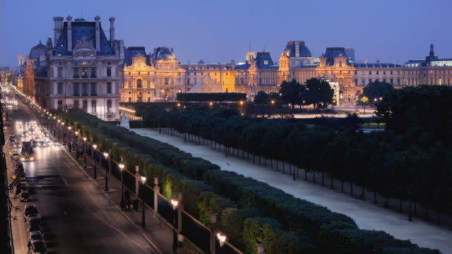 WS T/L View of Louvre traffic at night / Paris, France