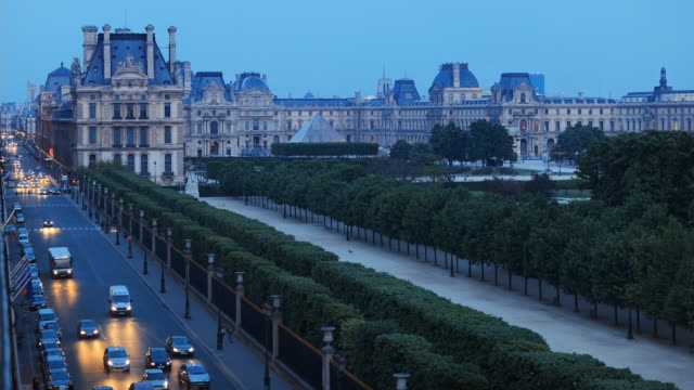 WS T/L View of Louvre traffic from dusk to night / Paris, France