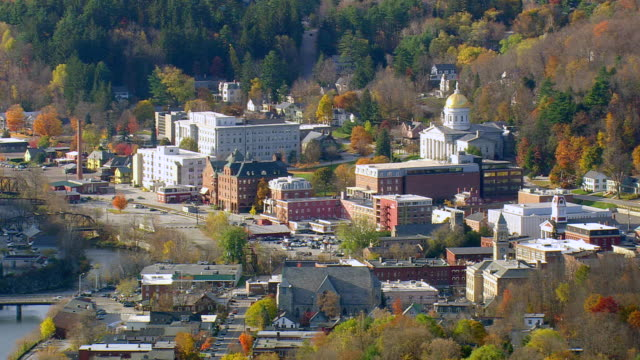 ws aerial pan zi view of low mist over montpelier city / vermont, united states - vermont state house stock videos & royalty-free footage