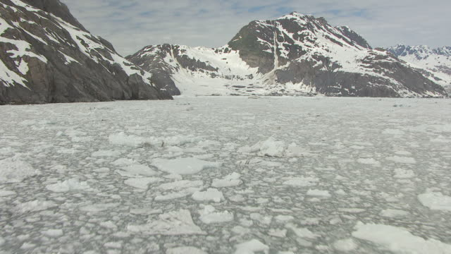 ms aerial tu view of low over slush and iceberg filled bay by columbia glacier / alaska, united states - columbia glacier stock videos & royalty-free footage