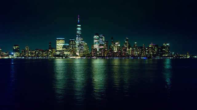 view of lower manhattan from across the hudson river at night - real time stock videos & royalty-free footage