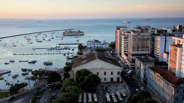 view of lower town, cicada baixa and san marcelo fortress at sunset, salvador, brazil, south america - kolonialstil stock-videos und b-roll-filmmaterial