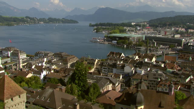 WS AERIAL View of Lucerne and lake lucerne with musegg wall and court church of St. Leodegar and townscape and lake promenade / Lucerne, Switzerland