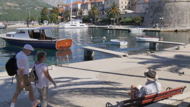 vídeos de stock e filmes b-roll de view of luka korculanska bay and korcula old town, korcula, dalmatia, croatia, europe - fotografia de três quartos
