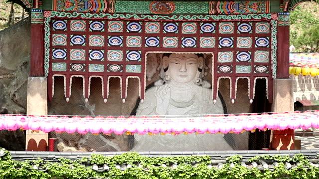 view of maaejwasang(stone buddha) and hanging paper lantern for celebration of buddha´s birthday in okcheonam(temple) - buddha's birthday stock videos and b-roll footage