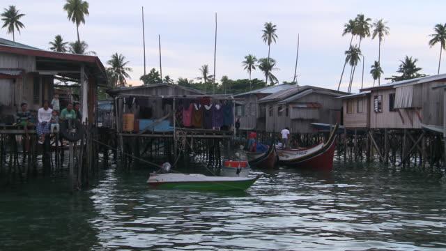 MS POV View of Mabul island and stilt village / Semporna, Sabah, Malaysia