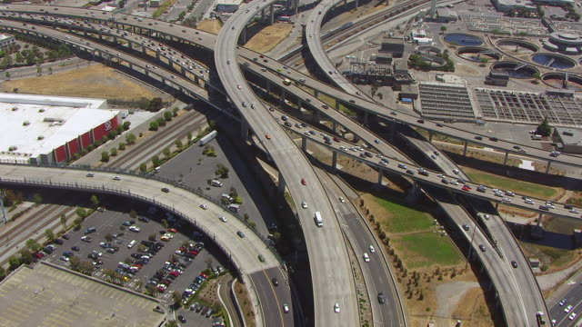 WS AERIAL POV View of MacArthur Maze overpass and Oakland Memorial Park / Berkeley, California, United States