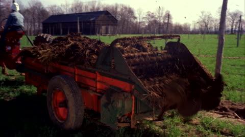 vidéos et rushes de ms cu view of  machine clearing out plant stubble  - machinerie