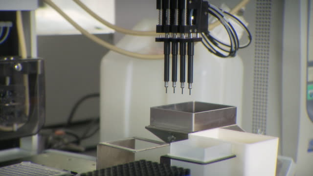 ms pov view of machines setting samples in lab / toronto, ontario, canada - medical sample stock videos & royalty-free footage