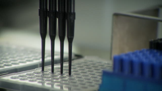 ms view of machines setting samples in lab / toronto, ontario, canada   - medical sample stock videos & royalty-free footage
