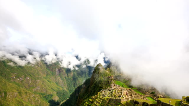 view of machu picchu (unesco world heritage site and icon of inca civilization) and cloudscape - machu picchu stock videos and b-roll footage