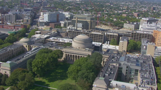 ws aerial pov view of maclaurin building and mit campus with cityscape / cambridge, massachusetts, united states - massachusetts stock-videos und b-roll-filmmaterial