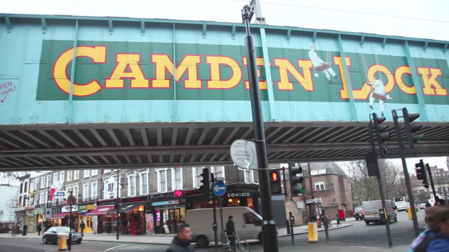 WS PAN View of main Camden Lock bridge at end of Camden High Street with traffic / London, Greater London, UK