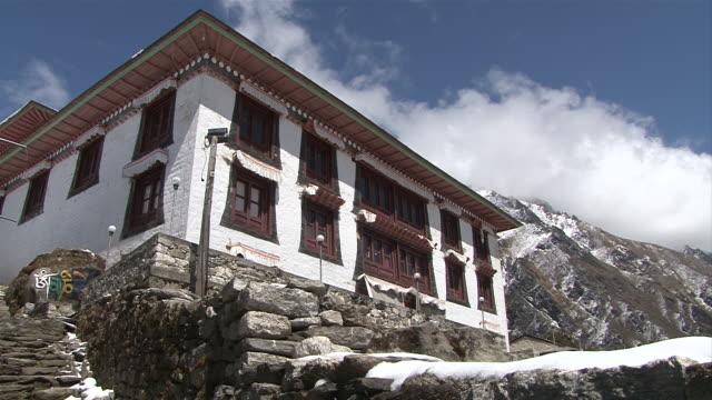 ws pan view of main gompa building at tengboche monastery at mountain panorama / tengboche,  khumbu region, nepal - khumbu stock videos and b-roll footage