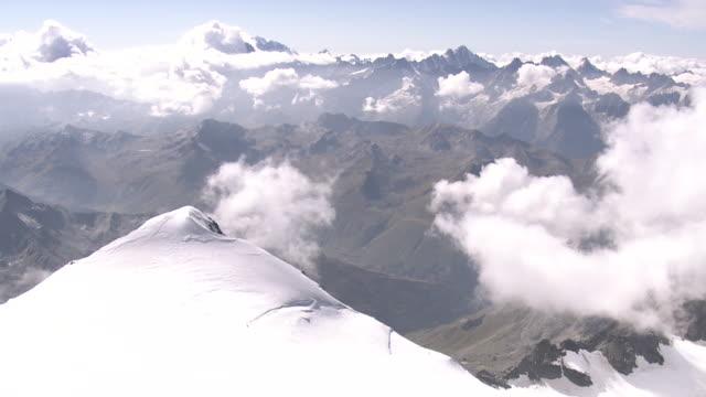 ws aerial view of majestic grand combin massif with peaks combin de la tsessette and combin de grafeneire / grand combin, valais, switzerland - majestic stock videos & royalty-free footage