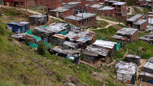 ms ha view of makeshift homes in a slum / bogota, colombia - trafficking stock videos and b-roll footage