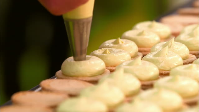 view of making multiple macarons - macaroon stock videos and b-roll footage