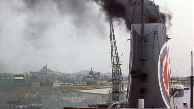 ms view of malasie sailboat leaving marseille harbor  - chimney stock videos and b-roll footage