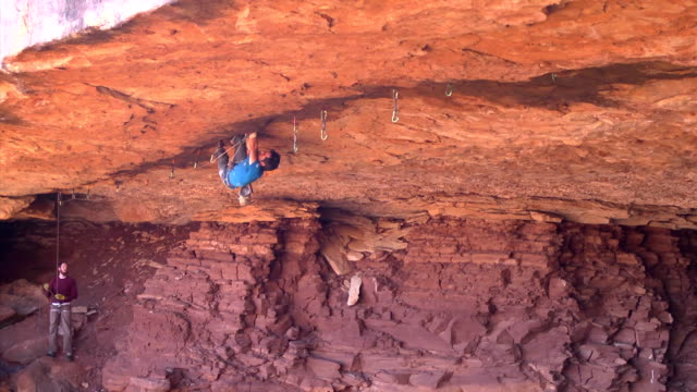 WS ZO View of male climber climbing crack upside down / Moab, Utah, United States
