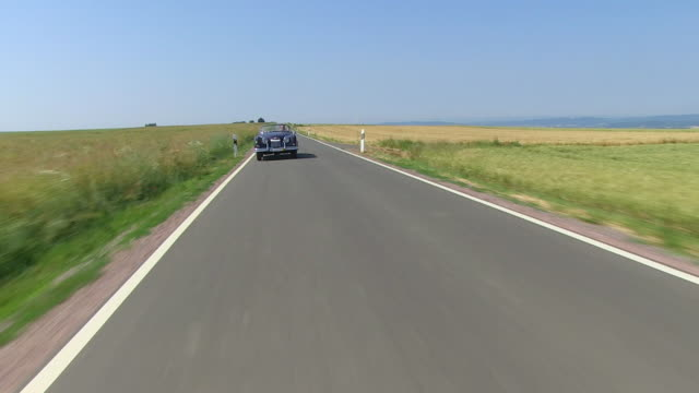 WS POV View of man driving with oldtimer through landscape / Saarburg, Rhineland Palatinate, Germany
