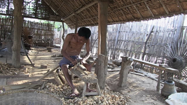 ws view of man grinding wood / bagan, mandalay division, myanmar - one mid adult man only stock videos & royalty-free footage