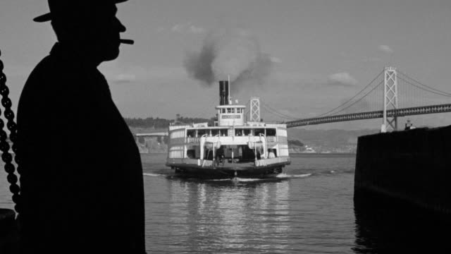 ms view of man on docks awaiting of ferry boat coming  - ferry stock videos & royalty-free footage