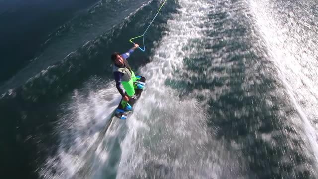 WS AERIAL SLO MO  ZI TS View of man on wakeboard trick / geneva, switzerland