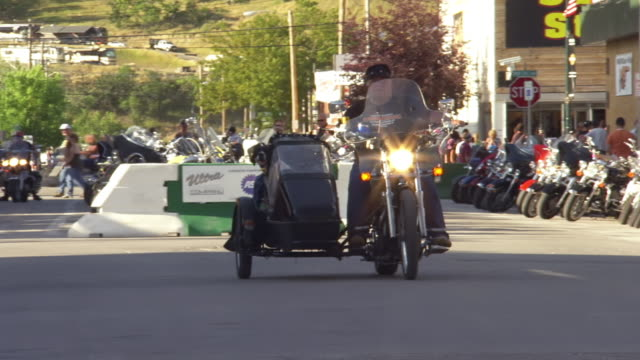 ws zo ts view of man riding motorcycle with dog in sidecar during sturgis motorcycle rally / sturgis, south dakota, united states - sidecar stock videos & royalty-free footage