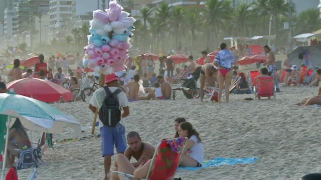 MS View of Man selling candy floss on Ipanema beach / Rio de Janeiro, Brazil