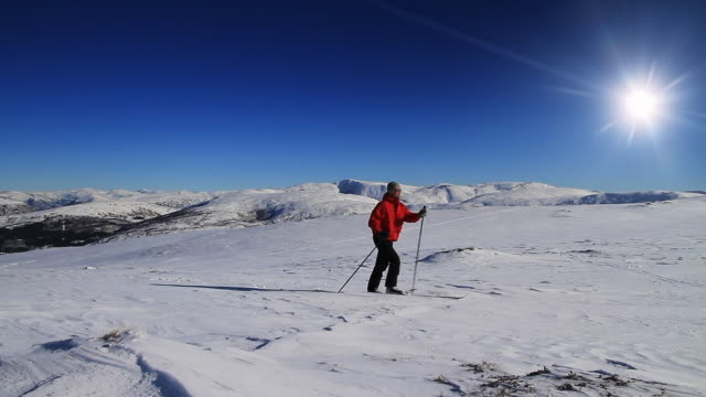 ws view of man skiing in mountains / bergen, hordaland, norway - norway stock videos & royalty-free footage