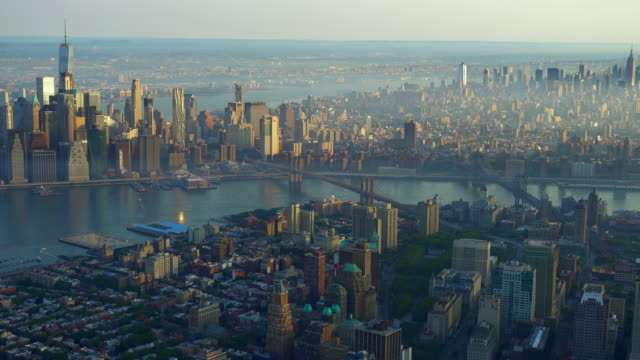 WS AERIAL POV View of Manhattan and Brooklyn Bridge, downtown in background / Manhattan, New York City, New York State, United States
