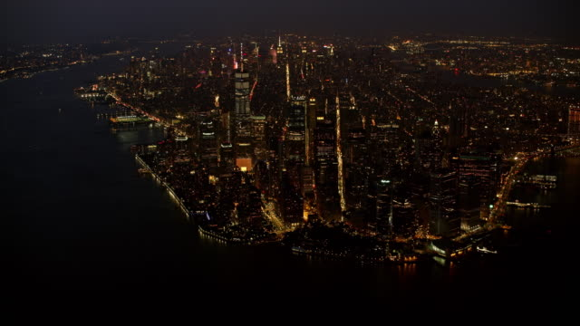 aerial view of manhattan at night from the new york harbor - new york harbor stock videos & royalty-free footage