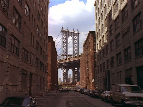 View of Manhattan Bridge from city side street / NYC
