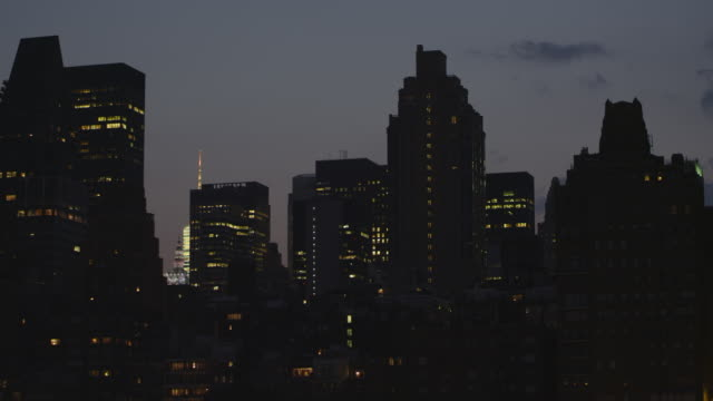 WS View of Manhattan Skyline & Empire State Building at Night / New York, United States