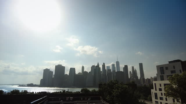 view of manhattan skyline with the world trade center from brooklyn heights promenade on a bright sunny day in new york city, new york on june 21,... - roof stock videos & royalty-free footage