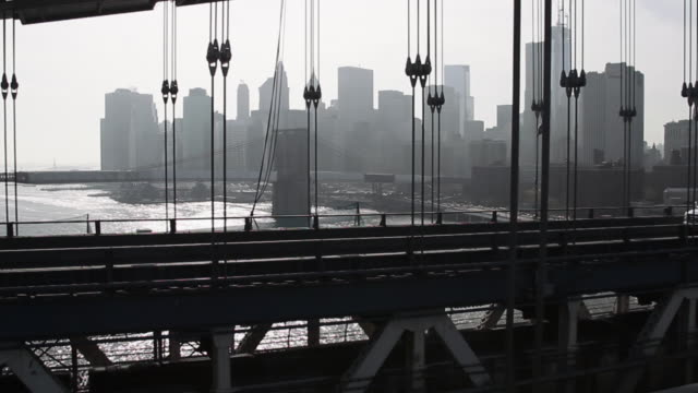 view of manhattan though the brooklyn bridge - manhattan stock videos & royalty-free footage