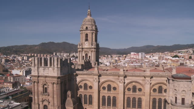 WS TU View of Manquita Malaga cathedral with cityscape / Malaga, Andalusia, Spain