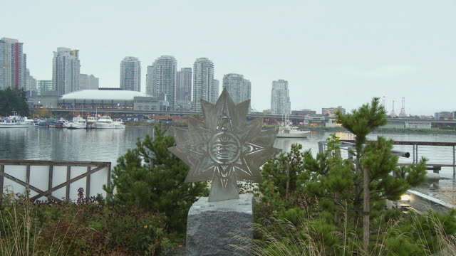 WS View of Maple leaf shaped sculpture in Athletes village with BC place in background / Vancouver, British Columbia, Canada