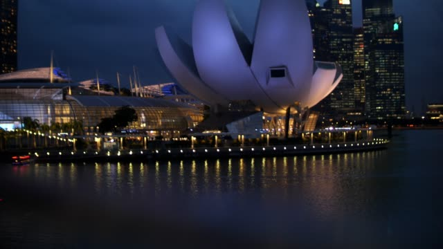 view of marina bay in singapore city - helix model stock videos & royalty-free footage