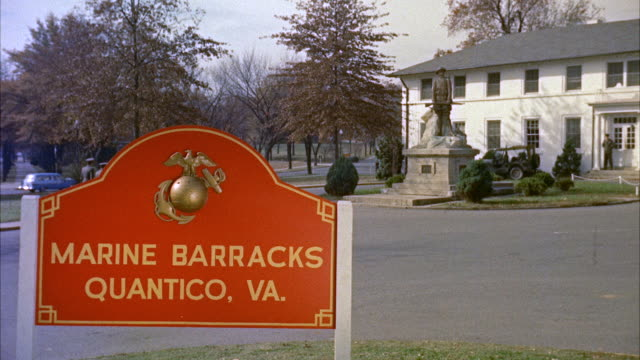 MS View of marine barracks - quantico sign and virginia company of marines marching