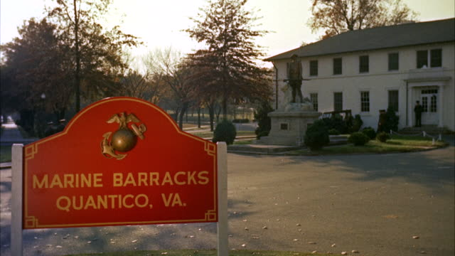 ms view of marine  barracks quantico sign and virginia - company of marines passing by road   - military base stock videos & royalty-free footage