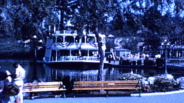 view of mark twain riverboat at the disneyland amusement park, anaheim, california; panning across restaurant near riverboat; people walking down... - mark twain stock videos & royalty-free footage