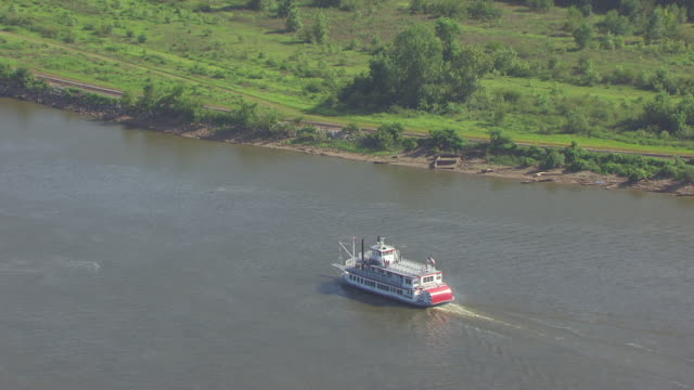 ws aerial zo view of mark twain riverboat traveling south on mississippi river by west bank / hannibal, missouri, united states - mark twain stock videos & royalty-free footage