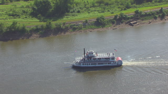 ws aerial zi view of mark twain riverboat traveling south on mississippi river by west bank / hannibal, missouri, united states - mark twain stock videos & royalty-free footage