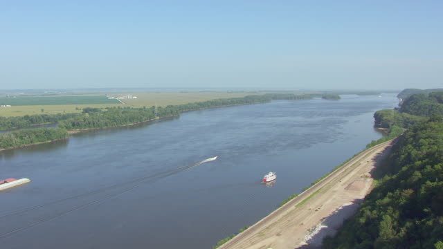 ws aerial view of mark twain riverboat traveling south on mississippi river / hannibal, missouri, united states - mark twain stock videos & royalty-free footage