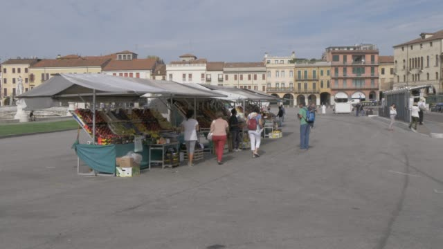view of market stalls and architecture in prato della valle, padua, veneto, italy, europe - prato stock videos and b-roll footage