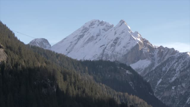 view of marmolada mountains and cable car from canazei on sunny day in winter, italian dolomites, unesco world heritage site, province of trento, trentino-alto adige/sudtirol, italy, europe - canazei video stock e b–roll