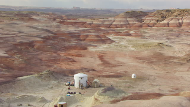 WS AERIAL ZI View of Mars desert research station in san Rafael desert and people getting onto motorcycles / Utah, United States