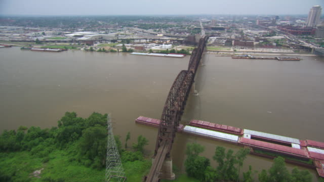 AERIAL WS DS View of Martin Luther Bridge over Mississippi river / St Louis, Missouri, United States