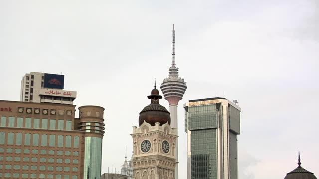 ms view of masjid jamek and menara kuala lumpur tower / kuala lumpur, malaysia - menara kuala lumpur tower stock videos and b-roll footage